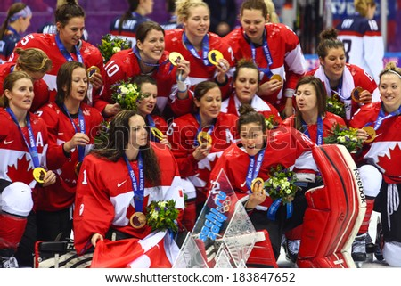 Sochi, RUSSIA - February 20, 2014: Canadian Women's Ice hockey team gold medalists, at medal ceremony after Gold Medal Game vs. USA team at the Sochi 2014 Olympic Games - stock photo