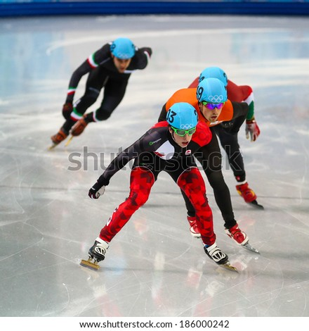 Sochi, RUSSIA - February 18, 2014: Charle COURNOYER (CAN), No. 203 at Men's 500 m Short Track Heats at the Sochi 2014 Olympic Games