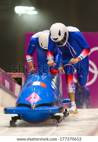 Sochi, RUSSIA - February 16, 2014: France 1 team at two-man bobsleigh heat at Sochi 2014 XXII Olympic Winter Games - stock photo