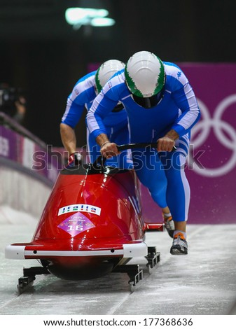Sochi, RUSSIA - February 16, 2014: Italy 1 team at two-man bobsleigh heat at Sochi 2014 XXII Olympic Winter Games - stock photo