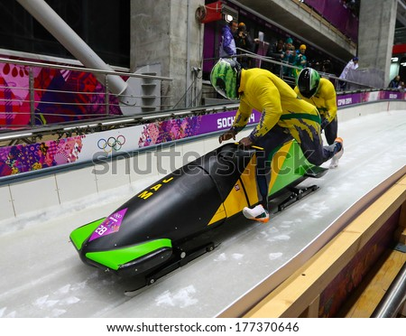 Sochi, RUSSIA - February 16, 2014: Jamaica 1 team at two-man bobsleigh heat at Sochi 2014 XXII Olympic Winter Games - stock photo