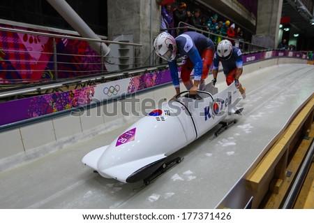 Sochi, RUSSIA - February 16, 2014: Korea 2 team at two-man bobsleigh heat at Sochi 2014 XXII Olympic Winter Games - stock photo