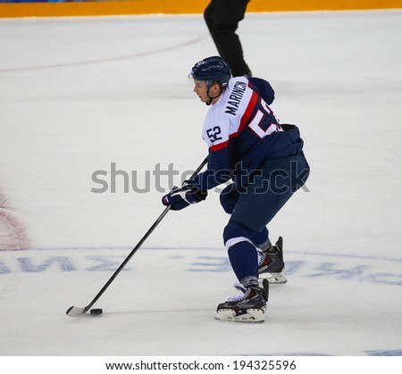 Sochi, RUSSIA - February 18, 2014: Martin MARINCIN (SVK) on ice during Ice hockey Men's Play-offs Qualifications Game vs. Czech Republic team at the Sochi 2014 Olympic Games