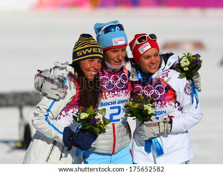 Sochi, RUSSIA -?? February 8, 2014: Medalists  of ladies' Skiathlon 7.5 km Classic + 7.5 km Free of Sochi 2014 XXII Olympic Winter Games on a flower ceremony - stock photo