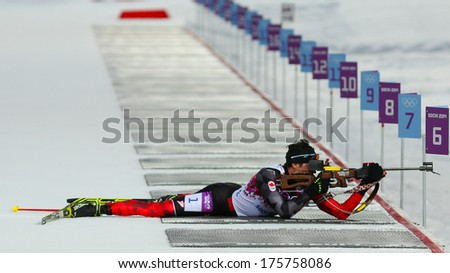 Sochi, RUSSIA - February 9, 2014: Nathan SMITH (CAN) during Biathlon Men's Sprint 10 km competition at Sochi 2014 XXII Olympic Winter Games - stock photo