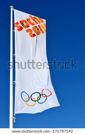 SOCHI, RUSSIA - FEBRUARY 7, 2014: Olympic flag with the symbol of the Sochi 2014 in Olympic park - stock photo