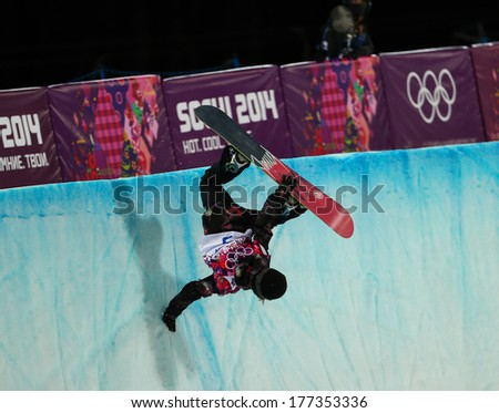 Sochi, RUSSIA - February 12, 2014: Sarka PANCOCHOVA (CZE) at snowboard competition during Ladies' Halfpipe Qualification at Sochi 2014 XXII Olympic Winter Games - stock photo