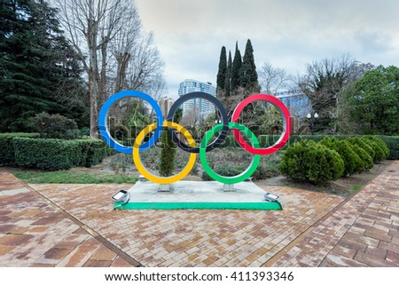 Sochi, Russia - February 7, 2016: Sculpture Olympic Rings on Navaginskaya Street in Sochi. Rings symbolize the unity of the five parts of the world and the global nature of the Olympic Games. - stock photo