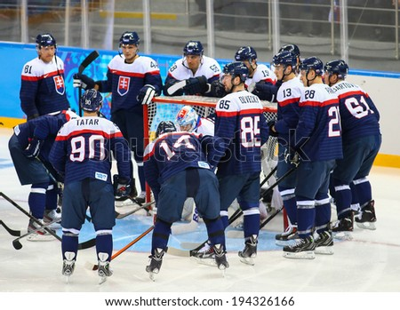 Sochi, RUSSIA - February 18, 2014: Slovakia team players on ice at start of Ice hockey Men's Play-offs Qualifications Game vs. Czech team at the Sochi 2014 Olympic Games