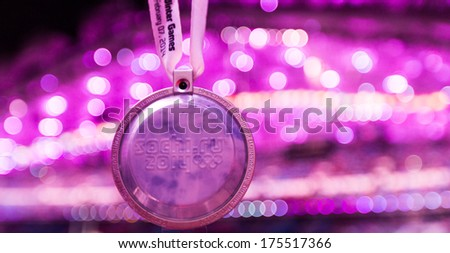 Sochi, RUSSIA  February 7, 2014: Spectator medal of Sochi 2014 XXII Olympic Winter Games - stock photo