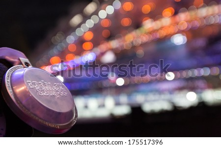 Sochi, RUSSIA  February 7, 2014: Spectator medal of Sochi 2014 XXII Olympic Winter Games - stock photo