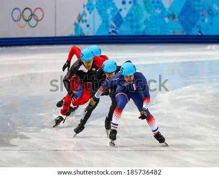 Sochi, RUSSIA - February 18, 2014: Thibaut FAUCONNET (FRA), No215 at Men's 500 m Short Track Heats at the Sochi 2014 Olympic Games - stock photo
