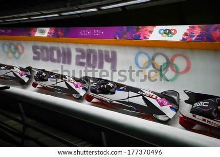 Sochi, RUSSIA - February 16, 2014: United States 3 team at two-man bobsleigh heat at Sochi 2014 XXII Olympic Winter Games - stock photo
