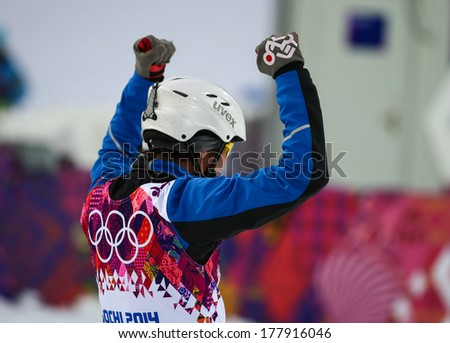 Sochi, RUSSIA - February 16, 2014: Zongyang JIA (CHN) at freestyle Skiing competition during Men's Aerials Qualification at Sochi 2014 XXII Olympic Winter Games - stock photo