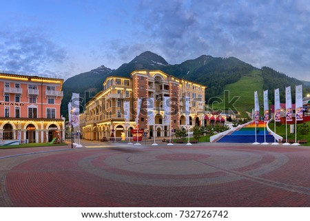SOCHI, RUSSIA - JUNE 23, 2017: Panorama of Sberbank Square in the Evening, Gorky Gorod, Sochi, Russia. Gorky Gorod hosted media events for the 2014 Winter Olympics.