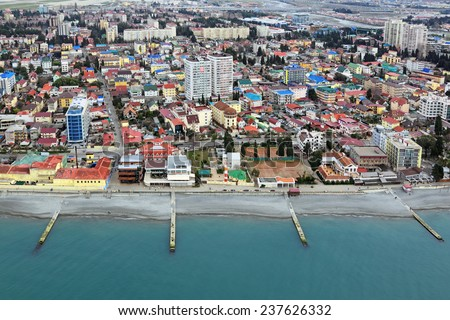 SOCHI, RUSSIA - MAR 02, 2014: Cityscape, view from above of a Adler district and black sea embankment - stock photo