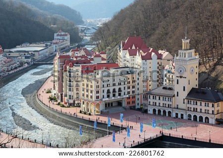 SOCHI, RUSSIA - MAR 26, 2014: Rosa Khutor Alpine ski Resort in Krasnaya Polyana - popular center of skiing and snowboard, venue for the 2014 winter Olympics - stock photo