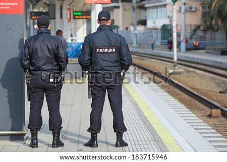 SOCHI, RUSSIA - MAR, 8, 2014: The two police officers patrols the railway station Hosta. Increased security measures because of the Olympic winter games - stock photo