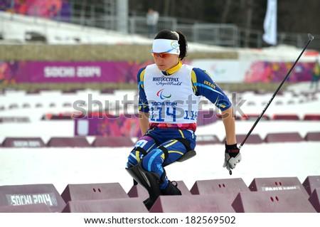 SOCHI, RUSSIA - March 9, 2014: Lyudmila Pavlenko (Ukraine) competes on Winter Paralympic Games  in Sochi. Biathlon, Women's 12,5 km, sitting - stock photo
