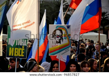 SOCHI, RUSSIA - MARCH 05: Peoples hold posters and headers with slogans in support of Vladimir Putin on presidential elections of the Russian Federation on March 05, 2012 in Sochi.