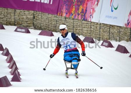 SOCHI, RUSSIA - March 9, 2014: Roman Petushkov (Russia) competes on Winter Paralympic Games  in Sochi. Biathlon, Men's 15 km, sitting - stock photo