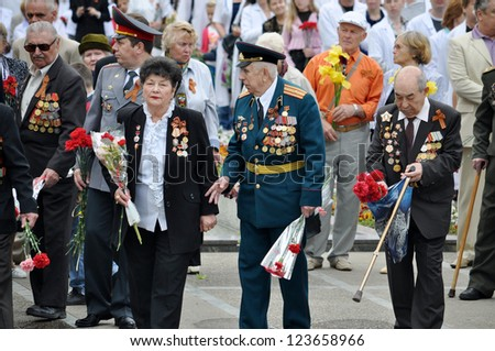 SOCHI, RUSSIA - MAY 9: Unidentified veterans lay flowers at Victory Monument during the celebration of Victory Day on May 9, 2012 in Sochi, Russia