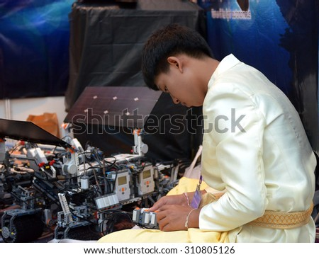 SOCHI, RUSSIA - November 21, 2014: Asian boy make a robot at the robot Olympiad in Sochi. Here there was the World Robotic Olympiad 2014. It was attended by delegates from 47 countries. - stock photo