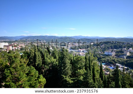 SOCHI, RUSSIA - SEPTEMBER, 2014: Cityscape of Sochi and mountains - stock photo