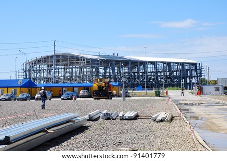 SOCHI, RUSSIA - SEPTEMBER 13: Construction of ice rink for curling in the Sochi Olympic Park September 13, 2011 in Sochi, Russia for the Winter Olympic Games 2014