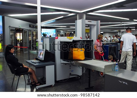 SOCHI, RUSSIA-SEPTEMBER 16: Inspection of baggage at International Sochi airport, which takes the 8th place in Russia on a passenger traffic whith more than 2 mln passengers a year September 16, 2010 - stock photo