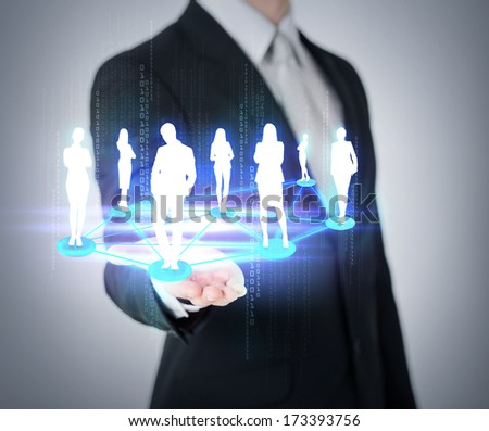 social and business concept - close up of mans hand showing social or business network - stock photo