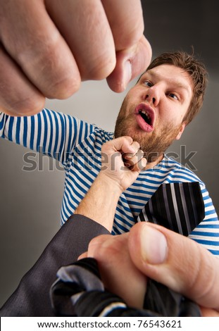 Social confrontation - bandit and businessman punching each other - stock photo