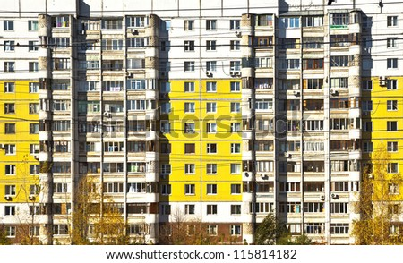 Social facade of an apartment building. Different balconies and yellow panels. Sleeping areas of Samara. - stock photo