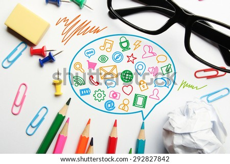 Social media concept with some office supplies around it on white background. - stock photo