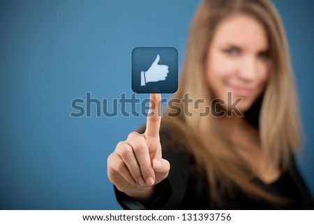 Social media concept. Young woman click on the like button.