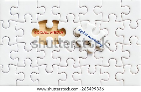 Social media digital marketing words on jigsaw puzzle background, business concept - stock photo