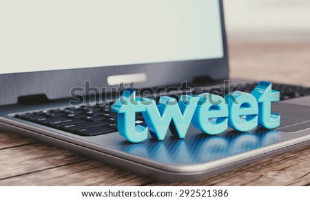 "Social media illustration concept: modern notebook with 3D ""tweet"" word."