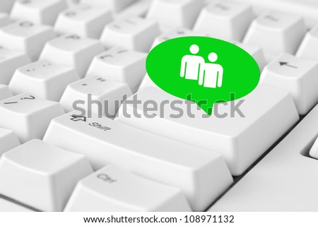 Social media key with people symbol in speech bubble sign on the keyboard - stock photo