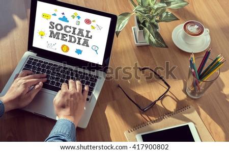 SOCIAL MEDIA man hand on table Business, coffee, Split tone - stock photo
