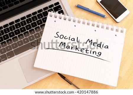 Social Media Marketing - handwritten text in a notebook on a desk - 3d render illustration. - stock photo