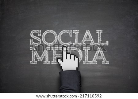 Social media on black blackboard with hand - stock photo
