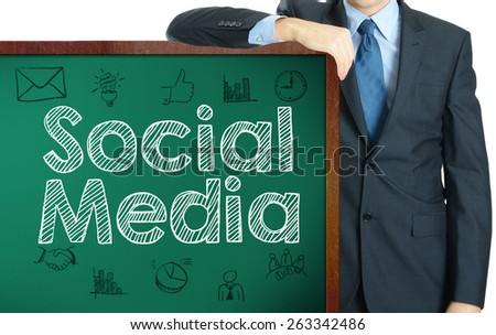 Social Media on blackboard presenting by businessman or teacher - stock photo