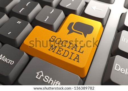 Social Media. Orange Button on Computer Keyboard. Social Media Concept. - stock photo