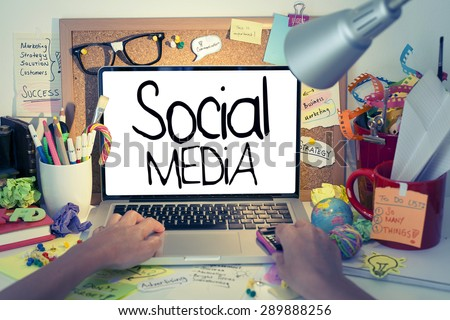 Social Media / Social media concept on laptop, hand typing on laptop keyboard in office interior - stock photo