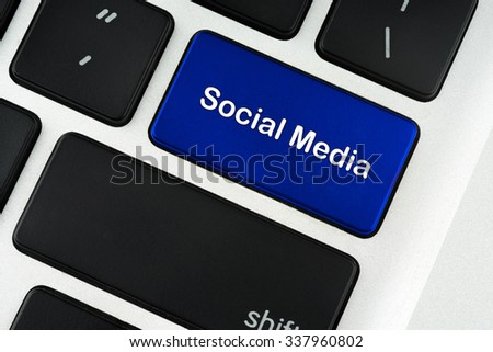 Social Media text on blue keyboard button - financial, business, online and data concept - stock photo