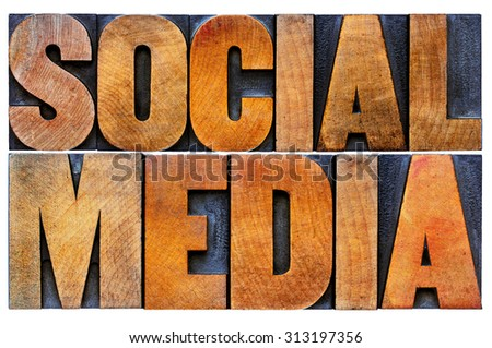 social media word abstract - isolated text in antique wood letterpress printing blocks with ink patina - stock photo