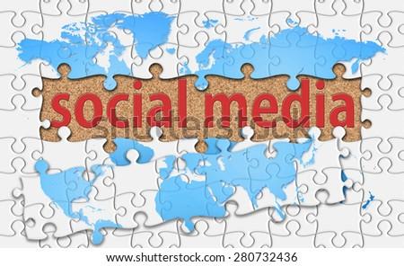 social media word with reveal jigsaw. - stock photo