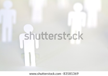 Social Network concept : close up of people cut out of paper on white background - stock photo