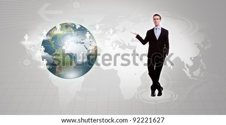 Social Network concept :young business man holding earth of social network - stock photo