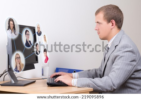 social network concept - young business man working with pc in office - stock photo